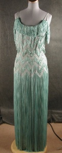 Aqua fringed silk and rayon evening dress, c. 1940 Transferred from the Fashion Institute of Technology, 1998.003.012