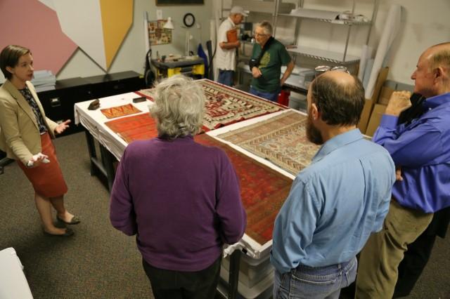 Visitors look at textiles